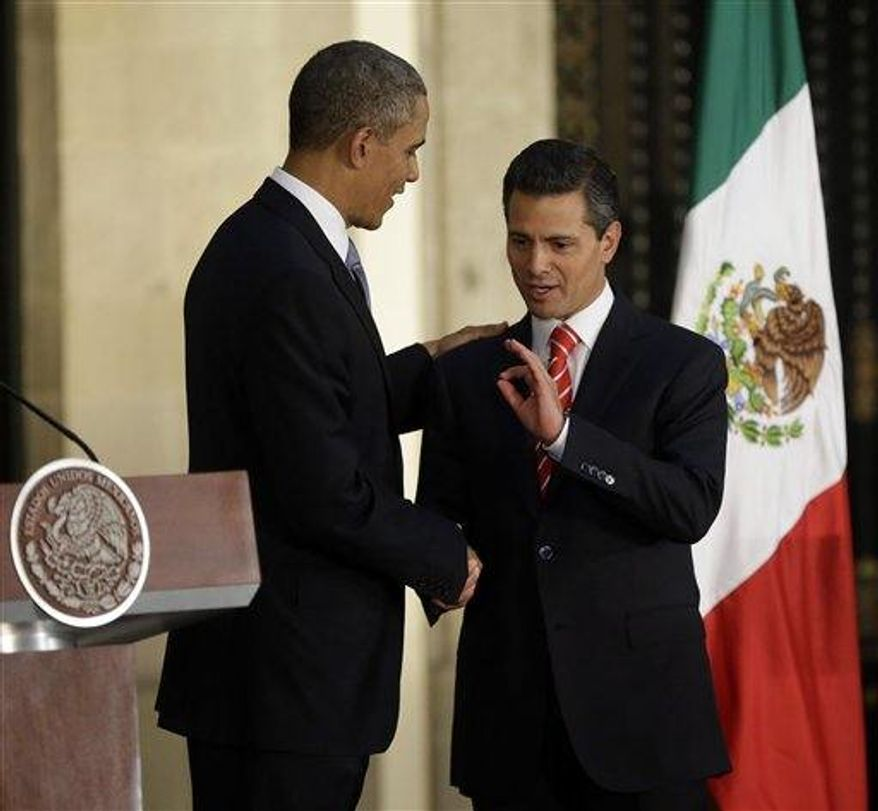 President Obama and Mexican President Enrique Pena Nieto shake hands following their news conference at the Palacio Nacional in Mexico City on May 2, 2013. (Associated Press) **FILE**
