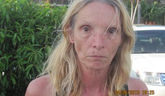 **FILE** An April 26, 2013, photo taken by the Monroe County, Fla. Sheriff's Office and released by the Lititz Borough, Pa., Police, is of Brenda Heist. Lititz Borough Police in central Pennsylvania say Heist, who disappeared after dropping off her children for school 11 years ago has been located in Florida after traveling there with homeless hitchhikers and sleeping under bridges. (Associated Press/Lititz Borough Police)