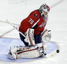 Washington Capitals goalie Braden Holtby (70) makes a save in the second period of Game 1 of a Stanley Cup NHL playoff hockey series against the New York Rangers, Thursday, May 2, 2013, in Washington. (AP Photo/Alex Brandon)