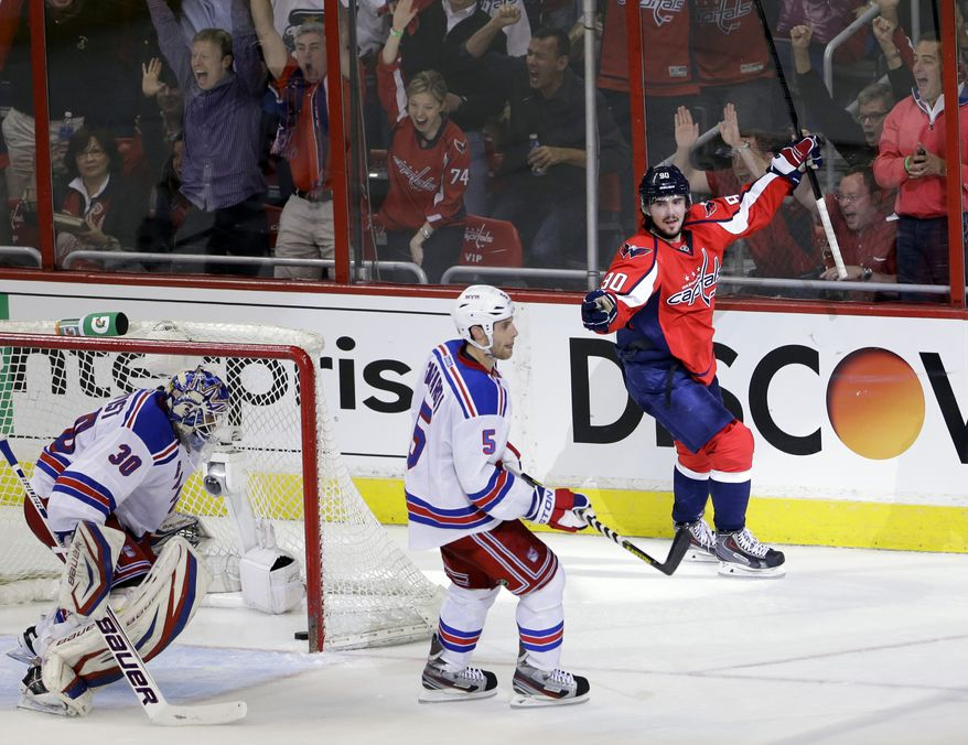 Washington Capitals center Marcus Johansson (90), from Sweden, celebrates his goal with New York Rangers goalie Henrik Lundqvist (30), also from Sweden, and defenseman Dan Girardi (5) standing nearby in the second period of Game 1 of a Stanley Cup NHL playoff hockey series on Thursday, May 2, 2013, in Washington. (AP Photo/Alex Brandon)