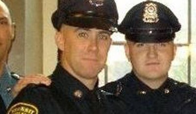 In this 2010 photo provided by the Massachusetts Bay Transportation Authority, Richard Donohue Jr., left, and Sean Collier pose together for a photo at their graduation from the Municipal Police Officers' Academy. On Thursday, April 18, 2013, Massachusetts Institute of Technology Police Officer Collier was fatally shot on the MIT campus, and transit police officer Donohue was shot and critically wounded. Authorities allege that Boston Marathon bombing suspects Tamerlan and Dzhokhar Tsarnaev were responsible. (AP Photo/Massachusetts Bay Transportation Authority)