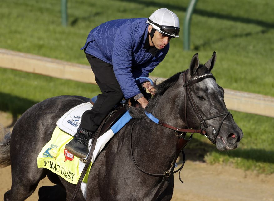 Exercise rider Victor Lebron rides Kentucky Derby hopeful Frac Daddy for a workout at Churchill Downs in Louisville, Ky., on April 30, 2013. (Associated Press)