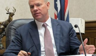**FILE** Wyoming Gov. Matt Mead addresses reporters at a press conference on April 5, 2013, at the state Capitol in Cheyenne. (Associated Press)
