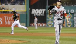 Washington Nationals starting pitcher Ross Detwiler, right, waits for a new ball as Pittsburgh Pirates' Jody Mercer, rounds the bases after hitting a two-run home run in the fifth inning of a baseball game Friday, May 3, 2013, in Pittsburgh. (AP Photo/Keith Srakocic)