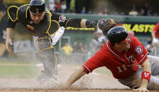 Washington Nationals' Ryan Zimmerman (11) scores ahead of the tag by Pittsburgh Pirates catcher Russell Martin (55) on a sacrifice fly to right field by Washington Nationals' Tyler Moore in the ninth inning of a baseball game at Pittsburgh Saturday, May 4, 2013. The Nationals won 5-4. (AP Photo/Gene J. Puskar)