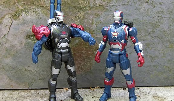 Mix and match parts from War Machine and Iron Patriot in Hasbro's Iron Man Assemblers collection. (Photograph by Joseph Szadkowski / The Washington Times)