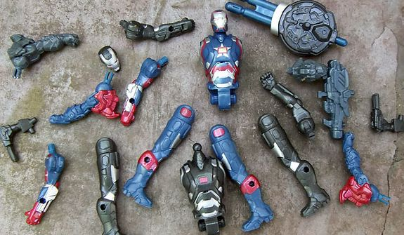Hasbro's Assemblers collection of Iron Man interchangeable armor pieces offers hundreds of combinations. (Photograph by Joseph Szadkowski / The Washington Times)