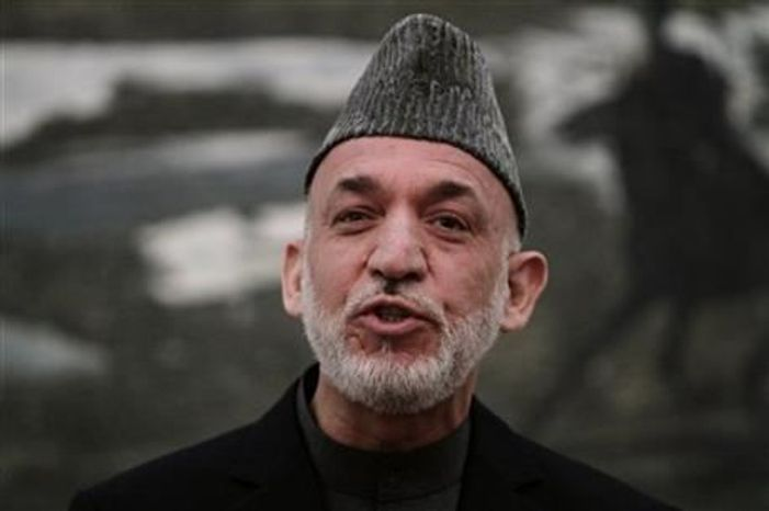 ** FILE ** Afghan President Hamid Karzai speaks during a news conference in Kabul, Afghanistan, on Saturday, May 4, 2013. (As