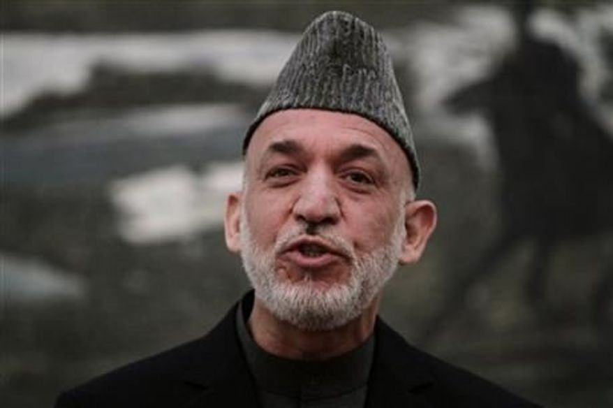 ** FILE ** Afghan President Hamid Karzai speaks during a news conference in Kabul, Afghanistan, on Saturday, May 4, 2013. (Associated Press)