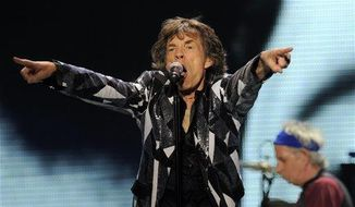 "Mick Jagger of the Rolling Stones performs on the kickoff of the band's ""50 and Counting"" tour at the Staples Center on Friday, May 3, 2013, in Los Angeles. (Chris Pizzello/Invision/AP)"