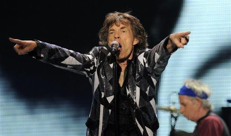 """Mick Jagger of the Rolling Stones performs on the kickoff of the band's """"50 and Counting"""" tour at the Staples Center on Friday, May 3, 2013, in Los Angeles. (Chris Pizzello/Invision/AP)"""