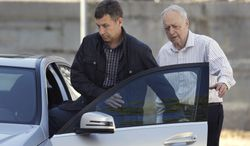 Ruslan Tsarni (left), an uncle of Boston Marathon bombing suspects Tamerlan and Dzhokhar Tsarnaev, leaves the Graham, Putnam and Mahoney Funeral Parlors in Worcester, Mass., as funeral director and owner Peter Stefan (right) walks him to the car on Sunday, May 5, 2013. Mr. Tsarni was making arrangements for Tamerlan Tsarnaev's burial rites. Mr. Stefan has pleaded for government officials to use their influence to persuade a cemetery to bury him, but so far no state or federal authorities have stepped forward. (AP Photo/Steven Senne)