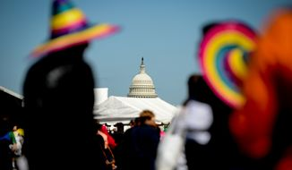 Visitors wear colorful Mexican hats at the annual Cinco de Mayo celebration on the National Mall in Washington on Sunday, May 5, 2013. (Andrew Harnik/The Washington Times)
