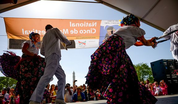 Dancers with the Maru Montero Dance Company perform onstage at the annual Cinco de Mayo celebration on the National Mall in Washington on Sunday, May 5, 2013. (Andrew Harnik/The Washington Times)