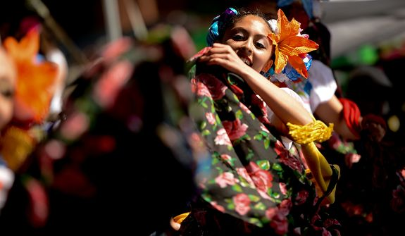 Stephanie Garcia, a dancer with the Maru Montero Dance Company, performs onstage at the annual Cinco de Mayo celebration on the National Mall in Washington on Sunday, May 5, 2013. (Andrew Harnik/The Washington Times)