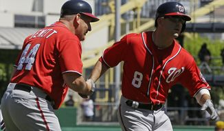 Washington Nationals' Danny Espinosa (8) rounds third to greetings from coach Trent Jewett after hitting a two-run home run off Pittsburgh Pirates starting pitcher Wandy Rodriguez, background right, during the fourth inning of a baseball game in Pittsburgh, Sunday, May 5, 2013. (AP Photo/Gene J. Puskar)