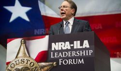 Wayne LaPierre, executive vice president and chief executive officer of the National Rifle Association, speaks during a leadership forum at the group's annual meeting on Friday, May 3, 2013, in Houston. (AP Photo/Steve Ueckert)