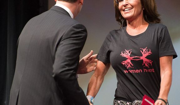 National Rifle Association's Institute for Legislative Action executive director Chris W. Cox, left, greets former Alaska Gov. Sarah Palin during the leadership forum at the National Rifle Association's annual meeting Friday, May 3, 2013 in Houston. (AP Photo/Steve Ueckert)