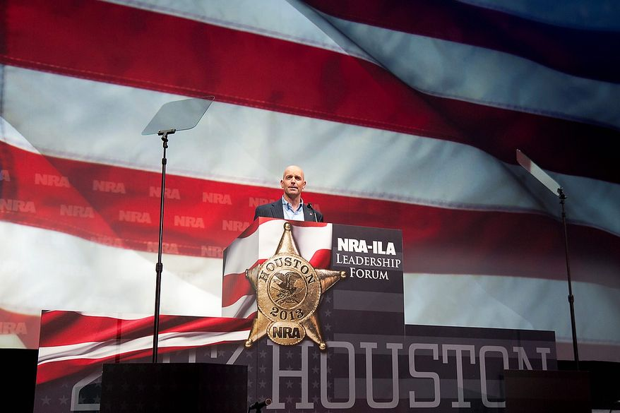 Retired U.S. Air Force Maj. Dan Rooney speaks during the leadership forum at the National Rifle Association's annual meeting Friday, May 3, 2013 in Houston. (AP Photo/Steve Ueckert)