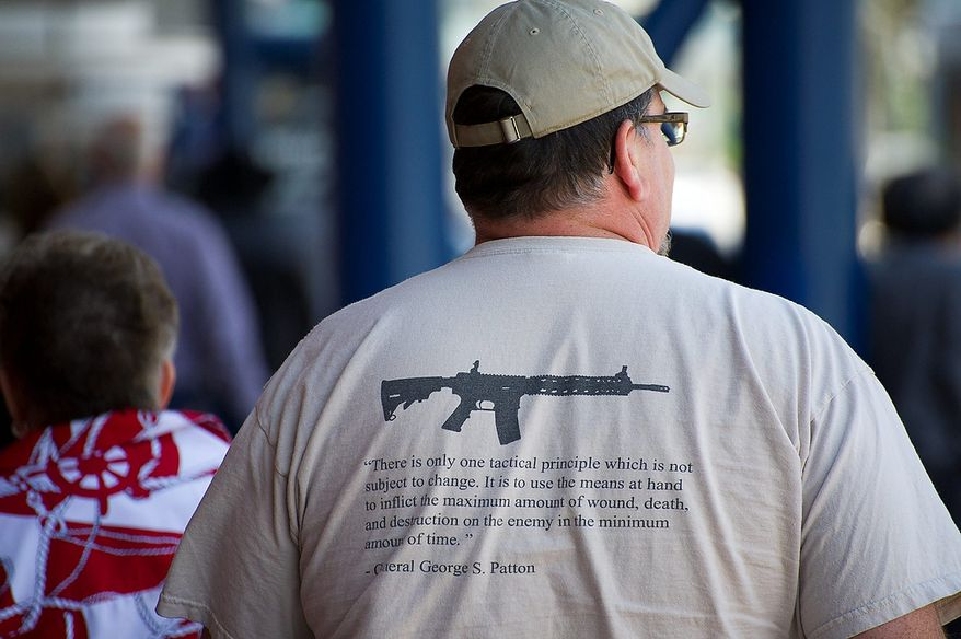 A man wearing a t-shirt quoting Gen. George S. Patton attends the National Rifle Association's annual convention Friday, May 3, 2013 in Houston. (AP Photo/Steve Ueckert)