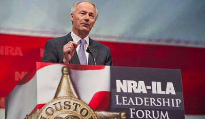Former U.S. Rep. Asa Hutchinson of Arkansas speaks during the leadership forum at the National Rifle Association's annual convention Friday, May 3, 2013 in Houston. (AP Photo/Steve Ueckert)