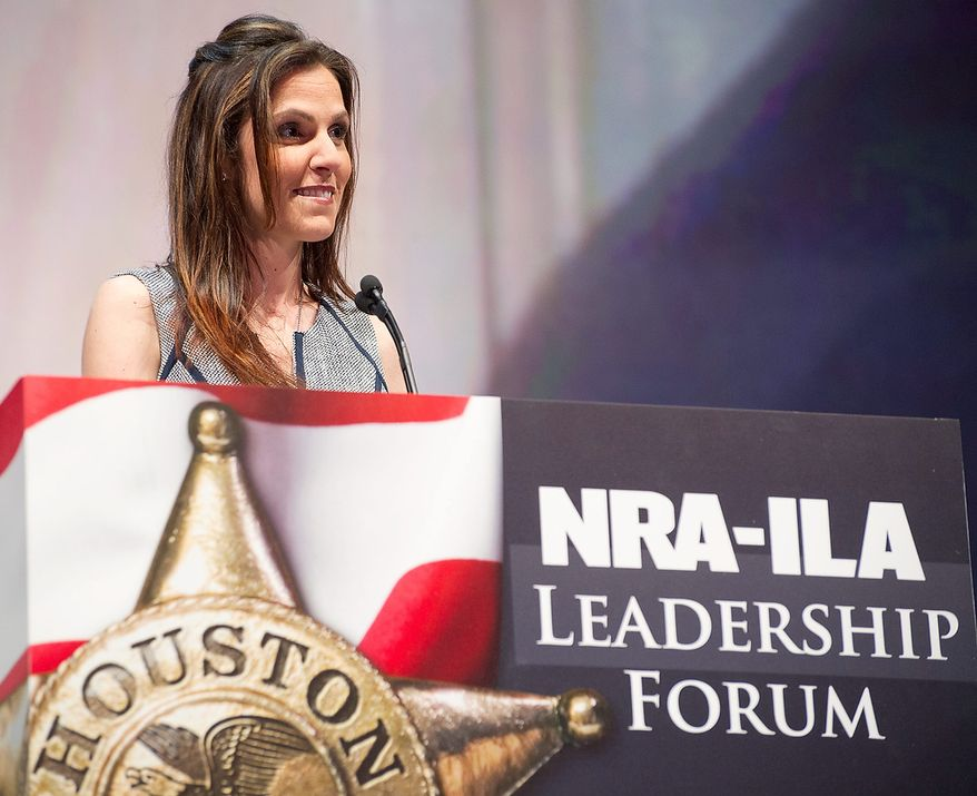 Taya Kyle, widow of author and former Navy SEAL sniper Chris Kyle, speaks during the leadership forum at the National Rifle Association's annual convention in Houston on May 3, 2013. (Associated Press) **FILE**