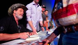 ** FILE ** NRA member and musician, Ted Nugent, greets fans and signs autographs at the National Rifle Association's 142 Annual Meetings and Exhibits in the George R. Brown Convention Center Sunday, May 5, 2013, in Houston. (AP Photo/Houston Chronicle, Johnny Hanson)