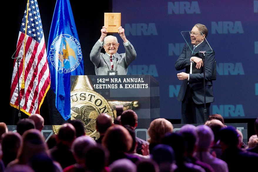 Born in 1917, the oldest life NRA member in attendance, Wayne Burd, holds up the plaque he received for being a member since 1938 next to Wayne LaPierre, executive vice president of the NRA during the NRA Annual Meeting of Members at the National Rifle Association's 142 Annual Meetings and Exhibits in the George R. Brown Convention Center Saturday, May 4, 2013, in Houston. National Rifle Association leaders told members Saturday that the fight against gun control legislation is far from over, with battles yet to come in Congress and next year's midterm elections, but they vowed that none in the organization will ever have to surrender their weapons. (AP Photo/Houston Chronicle, Johnny Hanson)