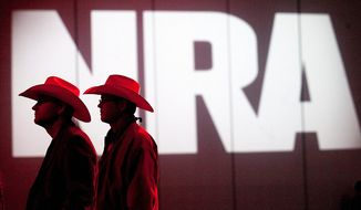 ** FILE ** NRA members listen to speakers during the NRA Annual Meeting of Members at the National Rifle Association's 142 Annual Meetings and Exhibits in the George R. Brown Convention Center Saturday, May 4, 2013, in Houston. (AP Photo/Houston Chronicle, Johnny Hanson)