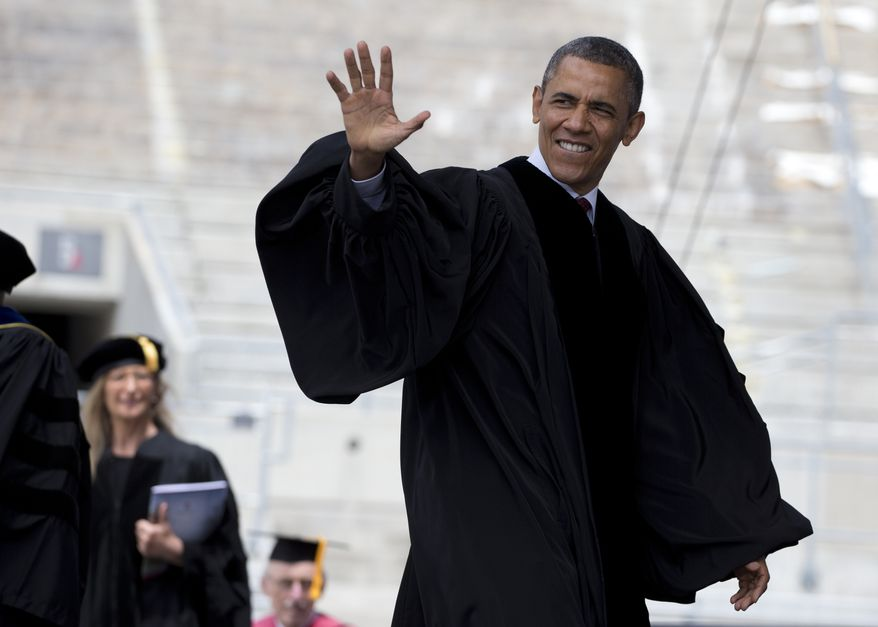 **FILE** President Obama arrives at the Ohio State University spring commencement at the Ohio Stadium on May 5, 2013, in Columbus. Mr. Obama is the third sitting president to give the commencement address at Ohio State. At left is photographer Annie Leibovitz. (Associated Press)