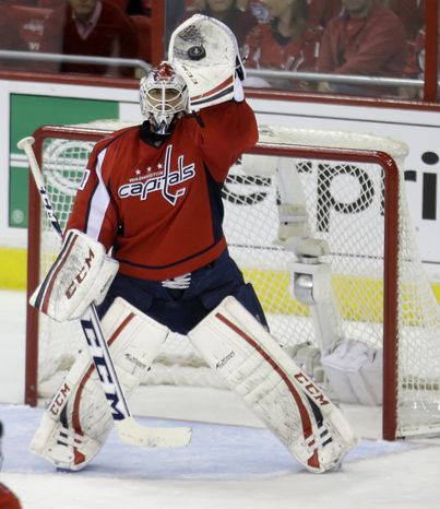 Washington Capitals goalie Braden Holtby makes a save during the third period of Game 2 of a Stanley Cup NHL playoff hockey series against the New York Rangers on Saturday, May 4, 2013, in Washington. The Capitals defeated the Rangers 1-0 in overtime. (AP Photo/Evan Vucci)
