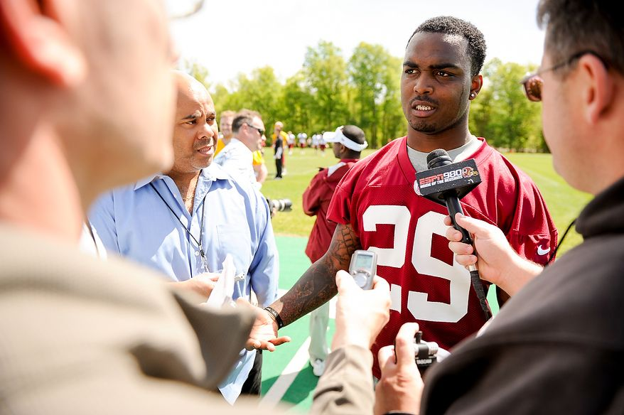 Washington Redskins safety Bacarri Rambo (29) talks to members of the media following rookie minicamp at Redskins Park in Ashburn, Va., on Sunday, May 5, 2013. Also pictured is tryout cornerback Akeem Auguste (second from left). (Andrew Harnik/The Washington Times)
