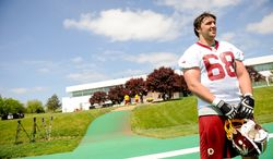 Tryout offensive lineman Michael Repovz (68) from Central Michigan University talks to a member of the media following the Washington Redskins' rookie minicamp at Redskins Park in Ashburn, Va., on Sunday, May 5, 2013. (Andrew Harnik/The Washington Times)