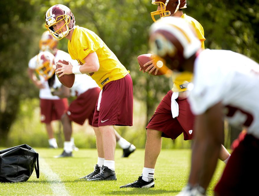 Quarterback Matthew McGloin (4) lines up during a passing drill at the Washington Redskins' rookie minicamp at Redskins Park in Ashburn, Va., on Sunday, May 5, 2013. (Andrew Harnik/The Washington Times)