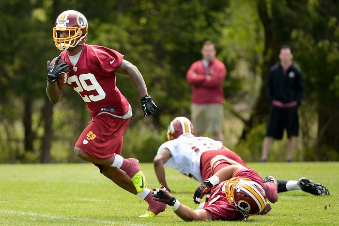 Washington Redskins safety Bacarri Rambo (29) runs with the ball after making an interception during a scrimmage at the team's rookie minicamp at Redskins Park in Ashburn, Va., on Sunday, May 5, 2013.