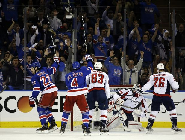 New York Rangers center Brian Boyle (22) celebrates after scoring against the Washington Capitals in the first period of Game 3 of their first-round NHL hockey Stanley Cup playoff series in New York, Monday, May 6, 2013. Rangers defenseman Michael Del Zotto (4), who was credited with an assist, also celebrates the goal. (AP Photo/Kathy Willens)