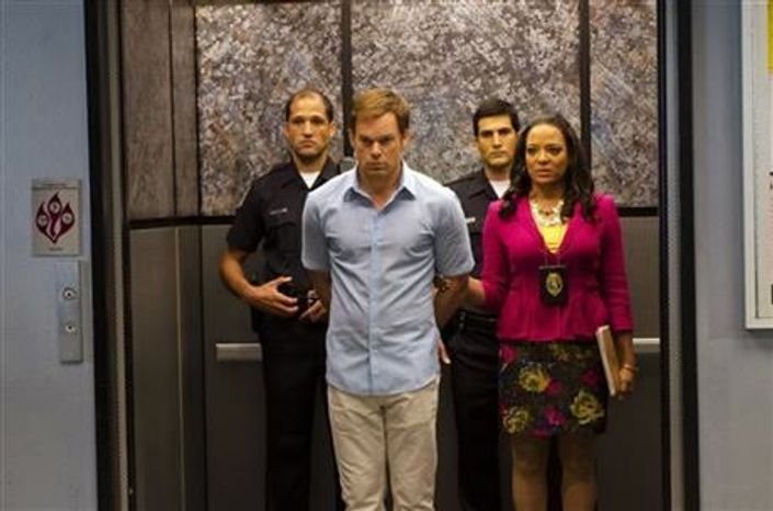 "Michael C. Hall, front left, as Dexter Morgan and Lauren Velez as Maria LaGuerta in a scene from Showtime's ""Dexter,"" appear in the undated promotional photo for Season 7, episode 12. (Associated Press)"