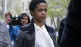 ** FILE ** Singer Lauryn Hill walks from federal court in Newark, N.J., on Monday, April 22, 2013. (Associated Press)