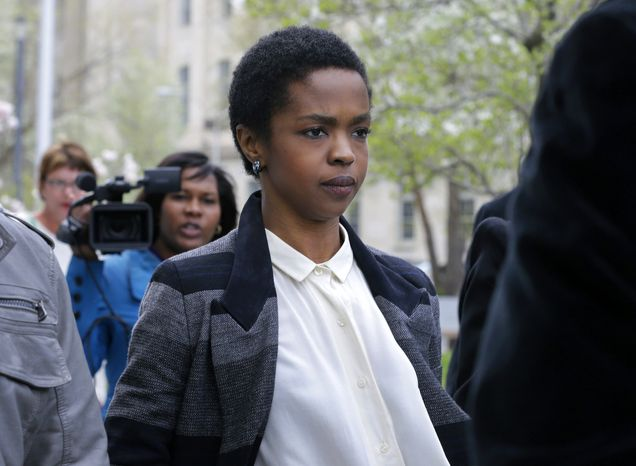 ** FILE ** Singer Lauryn Hill walks from federal court in Newark, N.J., on Monday, April 22, 2013. (Associated Pr
