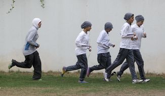 **FILE** Members of a Saudi female soccer team practice at a secret location in Riyadh, Saudi Arabia on May 21, 2012. (Associated Press)