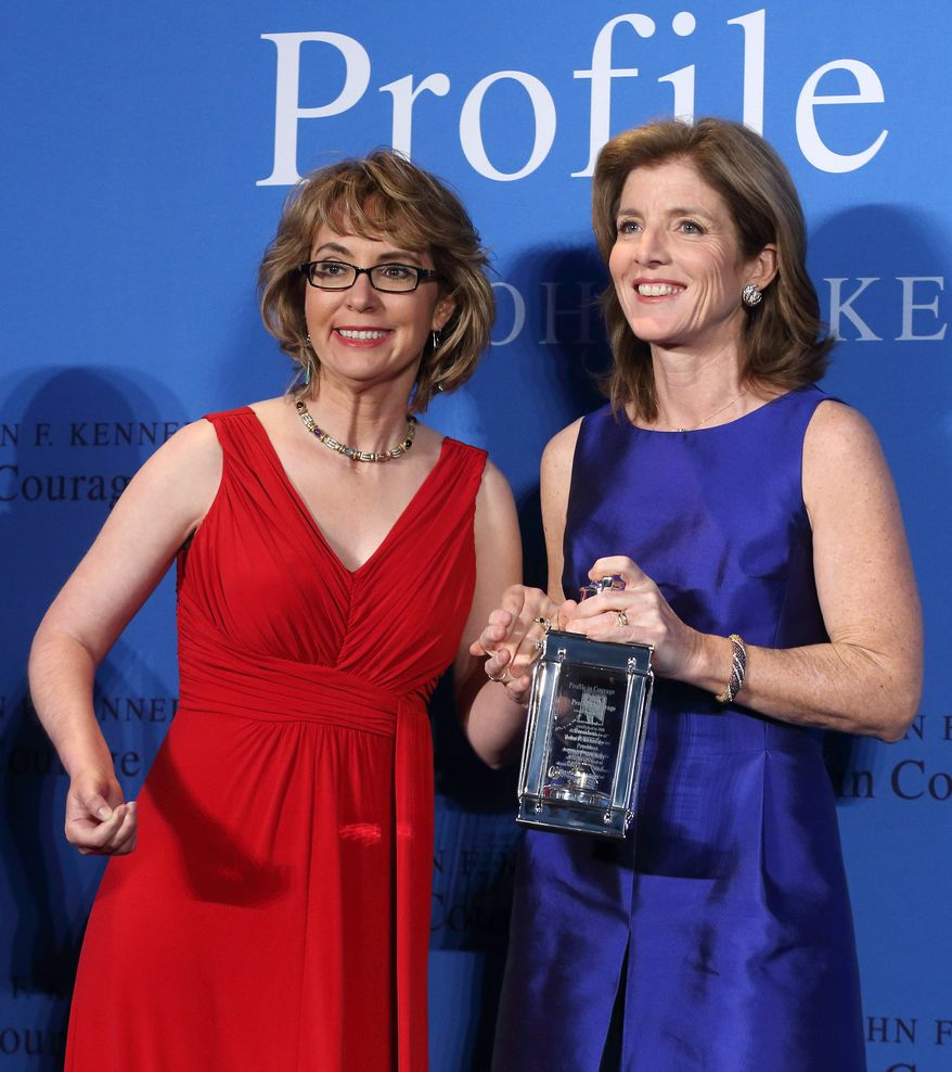 Caroline Kennedy (right) poses with former Arizona congresswoman Gabrielle Giffords after presenting her with the John F. Kennedy Profile in Courage Award at the JFK Library in Boston on May 5, 2013. (Associated Press)