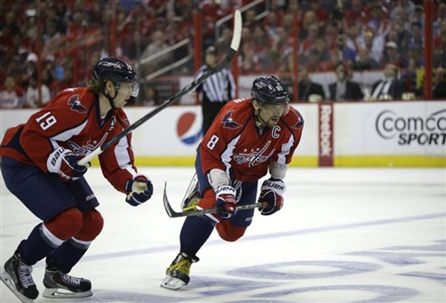 Washington Capitals center Nicklas Backstrom (19) and Washington Capitals left wing Alex Ovechkin (8) skate up the ice during the first period of Game 2 of a Stanley Cup NHL playoff hockey series against the New York Rangers on Saturday, May 4, 2013, in Washington. (AP Photo/Evan Vucci)