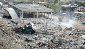 In this photo released by the Syrian official news agency SANA, damaged buildings wrecked by an Israeli airstrike are seen in Damascus, Syria, Sunday, May 5, 2013. Israeli warplanes struck areas in and around the Syrian capital early Sunday, setting off a series of explosions as they targeted a shipment of highly accurate, Iranian-made guided missiles believed to be on their way to Lebanon's Hezbollah militant group, officials and activists said.  (AP Photo/SANA)