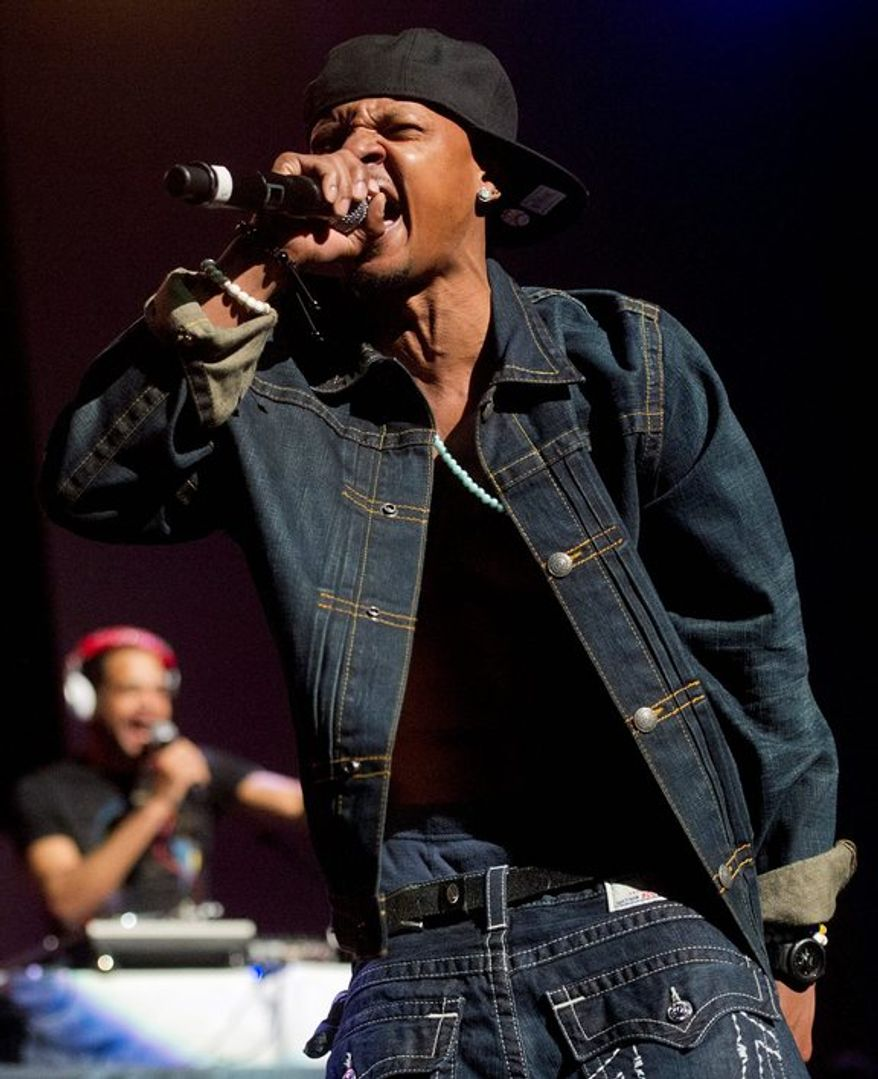 In this Feb. 23, 2013 photo, Chris Kelly of Kris Kross performs on stage at the Fox Theatre in Atlanta during the So So Def 20th Anniversary Concert. Kelly was found dead in his home, Wednesday, May 1, 2013, from a possible drug overdose. (AP Photo/Atlanta Journal-Constitution, Jonathan Phillips, File)