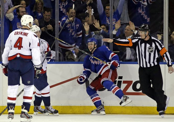 Washington Capitals defenseman John Erskine (4) watches as New York Rangers center Derek Stepan (21) reacts after scoring the winning goal in their 4-3 victory during the third period of Game 3 of their
