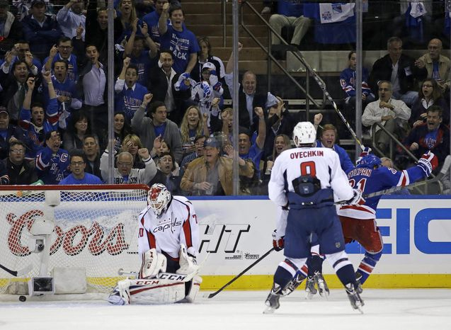 Washington Capitals left wing Alex Ovechkin (8), of Russia, watches as New York Rangers center Derek Stepan (21) celebrates after scoring the winning goal and Capitals goalie Braden Holtby (70) reacts in the third period of Game 3 of their first-round NHL hockey Stanley Cup playoff series in New York, Monday, May 6, 2013. The Rangers won 4-3. (AP Photo/Kathy Willens)