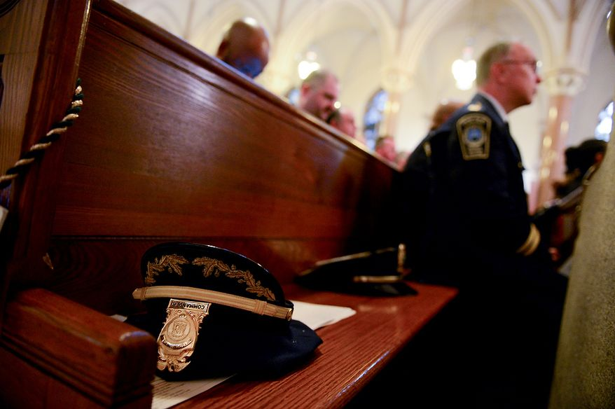 Officers hats lay on a pew during Blue Mass at St. Patrick Catholic Church, Washington, D.C., Tuesday, May 7, 2013. The Blue Mass is held to pray for those in law enforcement and fire safety, remember those who have fallen, and support those who serve at the beginning of National Police Week.  (Andrew Harnik/The Washington Times)