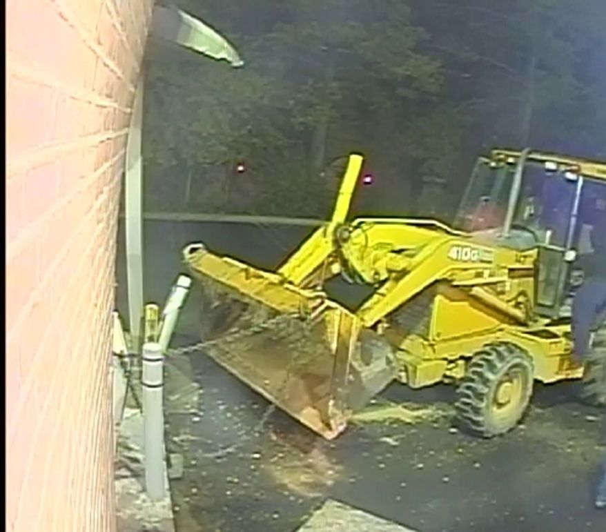 Thieves used a backhoe in an attempt to pry an ATM machine from a bank in Potomac (Photo courtesy of Montgomery County police)
