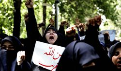Iranian and Syrian students chant slogans during an anti-Israeli demonstration in front of the U.N. office in Tehran, Iran, Monday, May 6, 2013. (AP Photo/Ebrahim Noroozi)