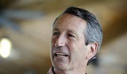 Former South Carolina Gov. Mark Sanford speaks with a vendor at the Mount Pleasant Farmers Market in Mount Pleasant, S.C., Tuesday, May 7, 2013. He faces Elizabeth Colbert Busch, the sister of political satirist Stephen Colbert, and Green Party candidate Eugene Platt, in Tuesday's balloting. (AP Photo/Rainier Ehrhardt)
